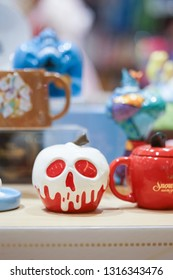 Bangkok, Thailand - Feb 17, 2019 : A photo of Disney Merchandises in stores with selective focus on the poisoned apple made from ceramic. Poison apple from Disney Snow (1937) animated film.