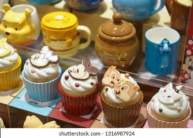 Bangkok, Thailand - Feb 17, 2019 : A photo of Disney Merchandises in stores with selective focus on Mickey Mouse ceramic cupcake. On the right is Chips & Dales the chipmunks.