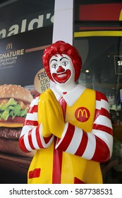 """Bangkok, Thailand- Feb 2017: Ronald McDonald charactor in front of McDonald restirant. In Thailand, this posture mean pay respect to and always use when we meet and say """"Hello"""""""