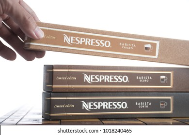 Bangkok, Thailand :Feb 2018. Three box of nespresso on wooden table. Nespresso coffee capsules is a type of pre-apportioned single-use container of ground coffee beans, sometimes with added flavoring.