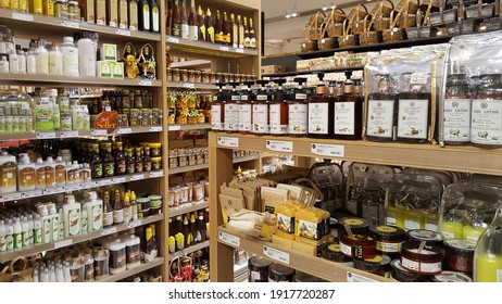 Bangkok, Thailand - Feb 2021: Wide range of organic extra virgin coconut oil beauty product (lotion, massage oil, soap bar, MCT oil, shampoo) on the wooden shelf at the organic shop, shopping mall.