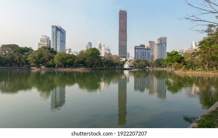 BANGKOK, THAILAND - FEB 21: Bangkok Skyline view from Lumpini Park, is public space, trees, and playgrounds in the Thai capital and contains an artificial popular area for jogger on Feb 21, 2021