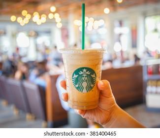 Bangkok ,Thailand- FEB 22 2016: Espresso Blended Beverages served in the hand inside of starbuck shop at Siam Paragon, Bangkok, Thailand.