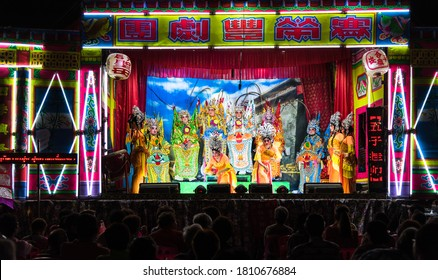 Bangkok, Thailand - Feb 23, 2020: Chinese opera actor perform on stage. Artist performing on stage during Chinese Ghost festival. Asia traditional arts and cultural performance.