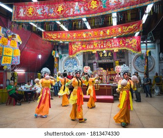 Bangkok, Thailand - Feb 23, 2020: Chinese opera actor perform on stage in the Chinese temple.Artist performing on stage during Chinese Ghost festival. Asia traditional arts and cultural performance.