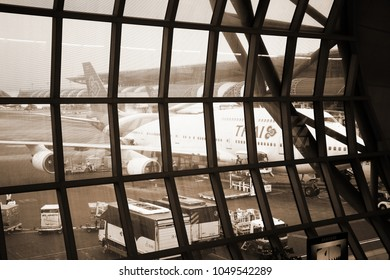 BANGKOK, THAILAND - FEB, 24: Airliner ground service crew on duty baggage loding in cabin before thai airways departure represent the airport service business on February 24, 2017 in Bangkok Thailand