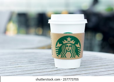 Bangkok, Thailand - Feb 26, 2015 : Starbucks take away coffee cup with logo on sleeve, Starbucks brand is one of the most world famous coffeehouse chains from USA.