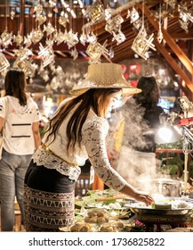 "BANGKOK, THAILAND, FEB 3, 2019: woman cooking thai food inside ""Icon Siam"" shopping center, Bangkok, Thailand"