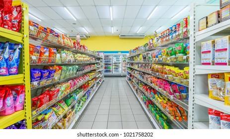Bangkok, Thailand - February 03, 2016: Rows of shelves in Tesco Lotus Express supermarket, Tesco Lotus is a hypermarket chain in Thailand