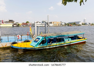 BANGKOK, THAILAND - FEBRUARY 05, 2020: Boat in a pier on Chao Phraya river in Bangkok, Thailand in February 2020