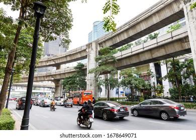 BANGKOK, THAILAND - FEBRUARY 05, 2020: Vehicle roads and sky train lines in Bangkok, Thailand in February 2020