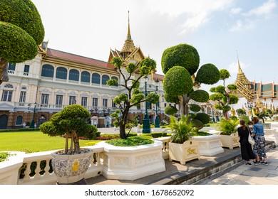 BANGKOK, THAILAND - FEBRUARY 05, 2020: Tourists visit famous landmark called Wat Phra Chetuphon temple in Bangkok, Thailand in February 2020