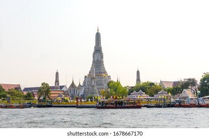 BANGKOK, THAILAND - FEBRUARY 05, 2020: Towers of ancient Wat Arun Ratchavararam temple buildings in Bangkok, Thailand