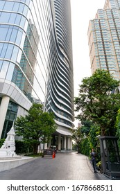 BANGKOK, THAILAND - FEBRUARY 05, 2020: Empty street between tall glass made skyscrapers in Bangkok, Thailand in February 2020