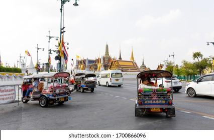 BANGKOK, THAILAND - FEBRUARY 05, 2020: Multiple tuk-tuk taxis on the street of Bangkok, Thailand in February 2020