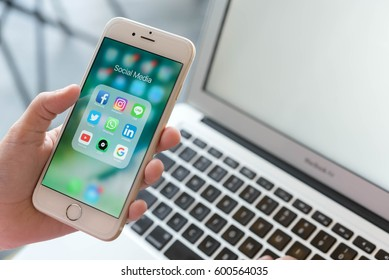 BANGKOK, THAILAND - FEBRUARY 06, 2017: Woman using Iphone6 with social media application set on screen