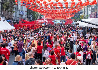 BANGKOK, THAILAND - FEBRUARY 08, 2016 : crowd people roams the street of Yaowarat during the celebration of Chinese New Year and Valentine's Day. Yaowarat is a Chinatown situated in Bangkok, Thailand