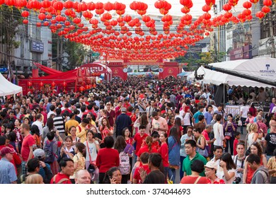 BANGKOK, THAILAND - FEBRUARY 08, 2016 : A crowd of people roams the street of Yaowarat during the celebration of Chinese New Year and Valentine's Day. Yaowarat is a Chinatown situated in Bangkok.
