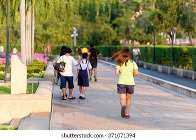 Bangkok, Thailand - February 1, 2016: Jogging people in public park in evening.