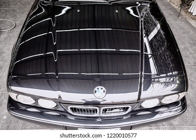 BANGKOK, THAILAND - FEBRUARY 10, 2018: The BMW 5 Series E34 M5 bonnet top view after cleaning and waxing. Illustration of M Power car details. Concept of car detailing and modification.