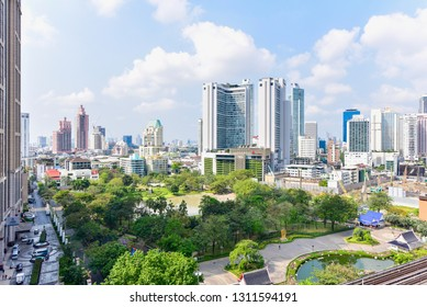Bangkok, Thailand - February 10, 2019: Modern Buildings and Benjasiri Park in Phrom Phong District