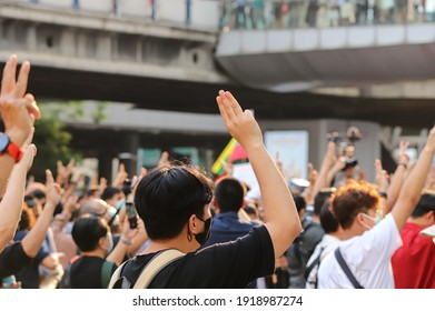 Bangkok, THAILAND - February 10, 2021: Pro-Democracy protesters protest at Pathumwan Intersection to hit the pot after the protesters not bailed out by the court the lese majeste case.