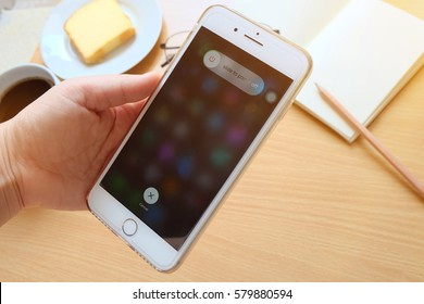 Bangkok, Thailand February 11, 2017:Hand holding Apple iPhone 7 plus with slide to power off option on the screen