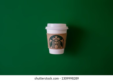 Bangkok ,Thailand - February 11 2019 :   A cup of Starbucks coffee with logo isolated on Starbucks green background