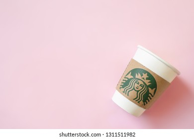 Bangkok ,Thailand - February 11 2019 : A cup of Starbucks coffee with logo isolated on pink background