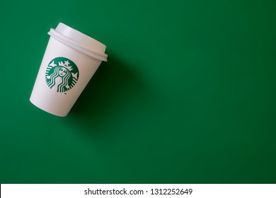 Bangkok ,Thailand - February 11 2019 : A cup of Starbucks coffee with logo isolated on Starbucks green background.