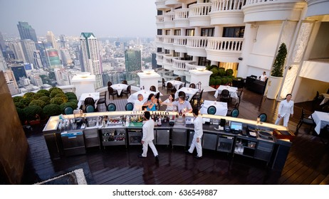 Bangkok, Thailand - February 13, 2017: Some people are celebrating for their special day, and the waitress are preparing to serve the beverage for them. Breeze, Lebua at state tower