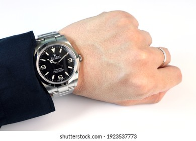Bangkok Thailand, February 14, 2012 The Rolex vintage wrist watch black oyster perpetual explorer I model is on the left wrist of a successful business man