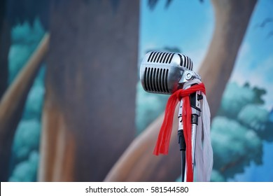 Bangkok, Thailand - February 14, 2016: Silver old fashioned stage microphone like shure (Elvis microphone). Karaoke, vocal learning, music shop or radio concept. Retro style mic ready to rock