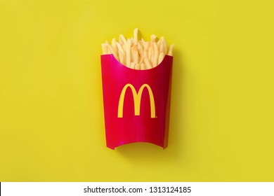 Bangkok ,Thailand - February 14 2019 : McDonald's French fries in the French fries box on yellow background. McDonald's Corporation is the world's largest fast food restaurant.