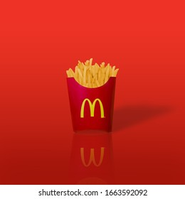 Bangkok ,Thailand - February 14 2019 : McDonald's French fries in the French fries box on red background. McDonald's Corporation is the world's largest fast food restaurant.