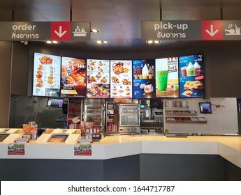 Bangkok, Thailand - February 14,2020 : KFC drive thru on Ramintra Rd., Opposite Synphaet Hospital. KFC is a fast food restaurant chain that specializes in fried chicken