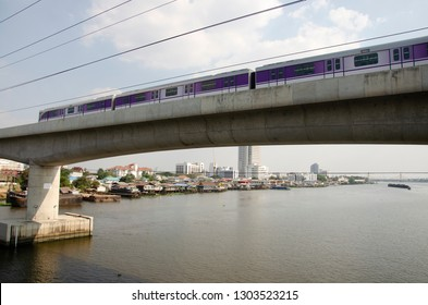 BANGKOK, THAILAND - FEBRUARY 16 : Skytrain Mass Rapid Transit Authority of Thailand MRTA or MRT Purple Line running go to bangkok across chao phraya river on February 16, 2017 in Bangkok, Thailand