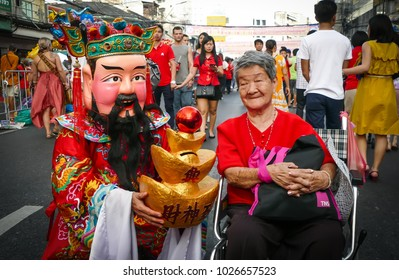 BANGKOK, THAILAND - FEBRUARY 16: Unidentified people  dress up like god of wealth in Bangkok's Chinatown district during the Chinese New Year celebration on February 16, 2018 in Bangkok, Thailand