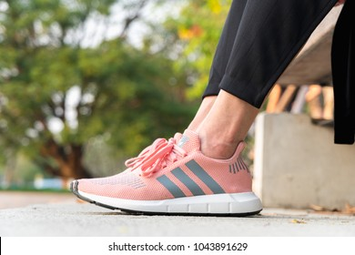 premium selection a16a0 cdda1 BANGKOK, THAILAND - FEBRUARY 17, 2018   Women wearing adidas swift run w  2017