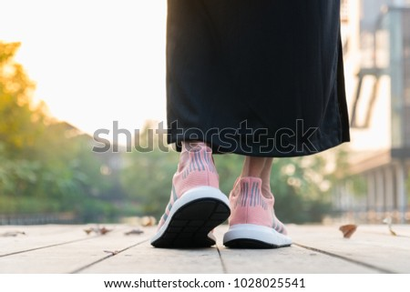 fc98bfb4 BANGKOK, THAILAND - FEBRUARY 17, 2018 : Women wearing adidas swift run w  2017 sports shoes for running for women on street outdoor - illustration  editorial ...