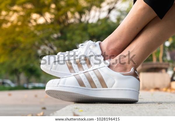 0d854d08 BANGKOK, THAILAND - FEBRUARY 17, 2018 : Women wearing Adidas Superstar W  white/