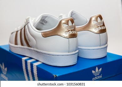 BANGKOK, THAILAND - FEBRUARY 18, 2018 : Adidas superstar W white/gold shoes with popular fashion for woman in Thailand.