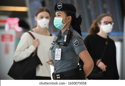 Bangkok, Thailand - February 18, 2020: A masked security guard look-on at the departures hall of Suvarnabhumi Airport. Thailand has been assessed as most at risk of Covid-19 virus outside of China.