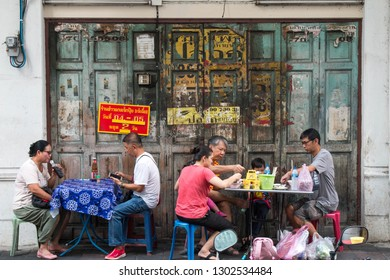 BANGKOK, THAILAND - February 2, 2019 : Unidentified Thai Asian people who' re sit on chair for eating curry rice street food on footpath at Chinatown (Yaowarat) on Bangkok, Thailand.