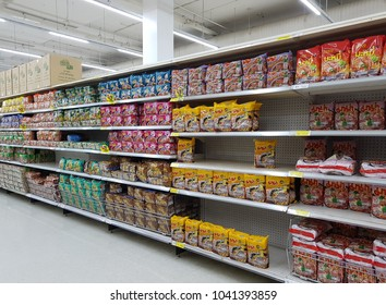 Bangkok, Thailand - February 20, 2018 : Rows of shelf at Tesco Lotus selling multiple brands of instant noodles.