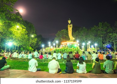 Bangkok, Thailand - February 20, 2018: The special day of Buddhism Makha Bucha day or Vesak Day. A Buddhist ceremony where people walk with lighted candles in hand around a temple at Thailand.