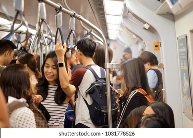 Bangkok, Thailand- February 2018: Atmosphere in the BangkokMRT during peak hour. Soft focus due to moving train
