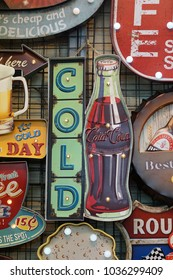 Bangkok, Thailand- February 2018: Vintage metal Coca Cola sign on sale at the Chatuchak weekend market Bangkok, Thailand. Coca Cola is a carbonated softdrinks produce by the Coca Cola company.