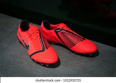 "Bangkok / Thailand - February 2019 : Nike football launched the new football boots ""Phantom Venom"", this model is designed for striker player. Presented by Harry Kane, Marcus Rashford and Lewandowski."