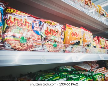 """Bangkok, Thailand - February, 2019: Popular thai instant noodle """"MAMA"""" for sale on a convenience store or supermarket shelf. Known for poor salaryman food."""